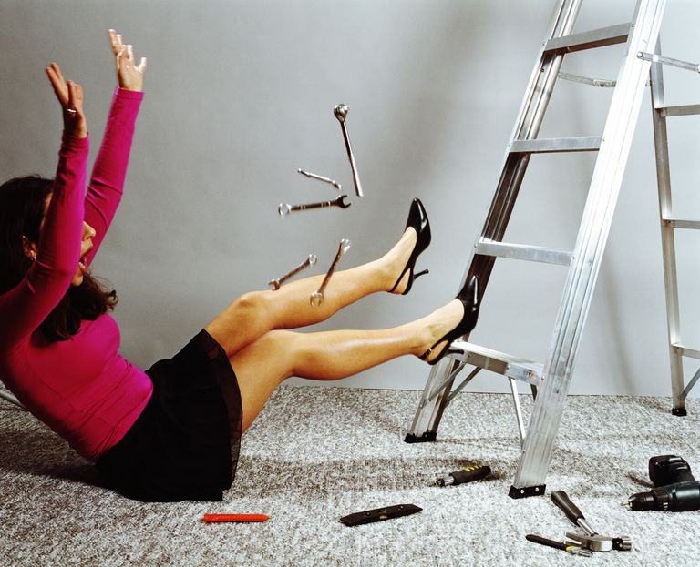 Women in a pink shirt and black skirt falling off a ladder