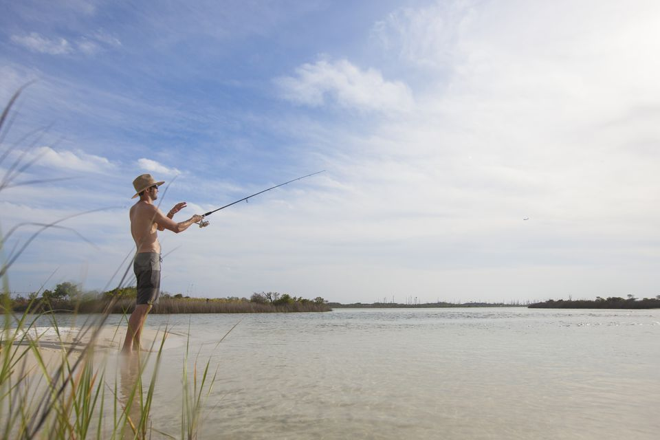 A man fishing in shallow water near Fort Walton Beach, Florida