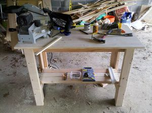 An Unfinished Workbench In A Garage