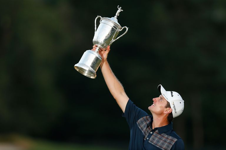 The US Open trophy held aloft by 2013 winner Justin Rose.