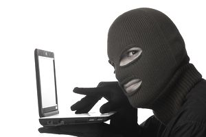 Photograph of a hacker; learn how to stop him from stealing your information.