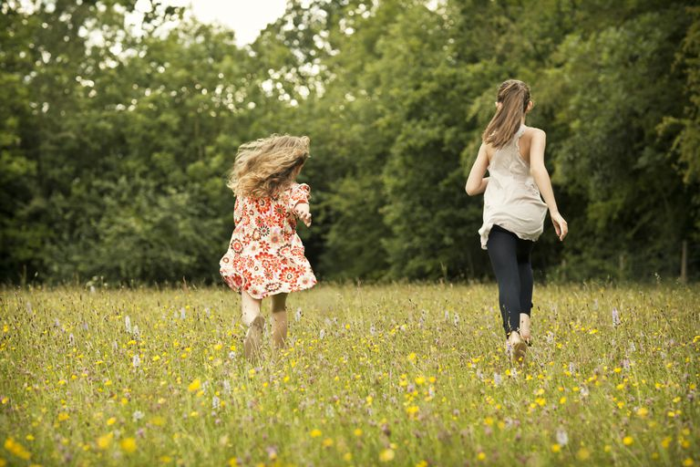 Young girls running in a meadow