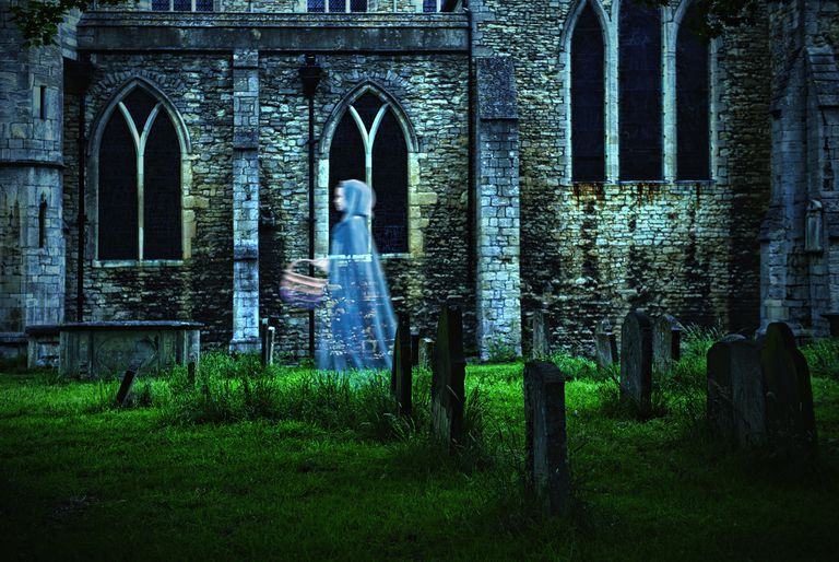 Ghostly Figure of Woman in Graveyard