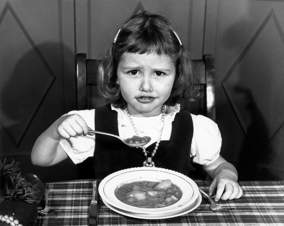 Child in the 50s balks at eating all her food.