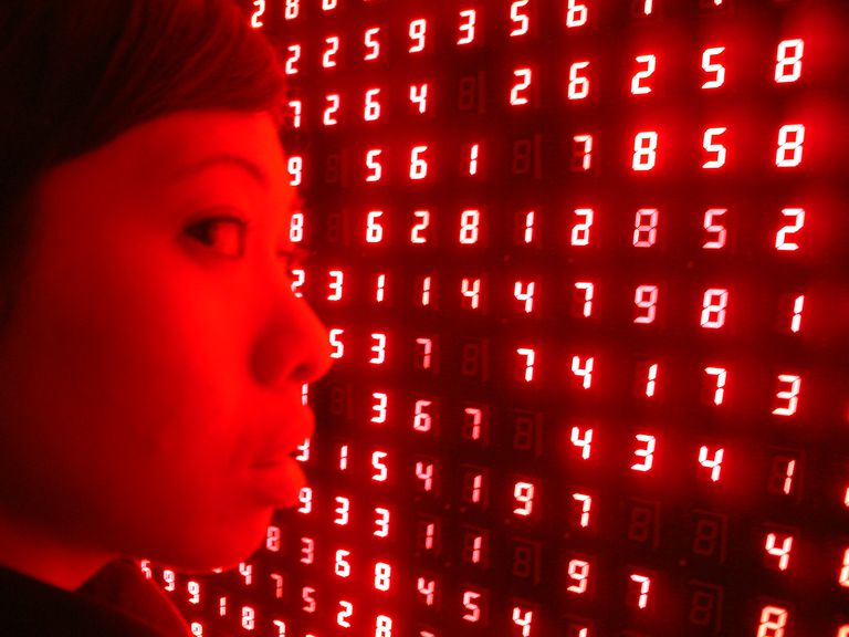 Girl and Illuminated Red Numbers