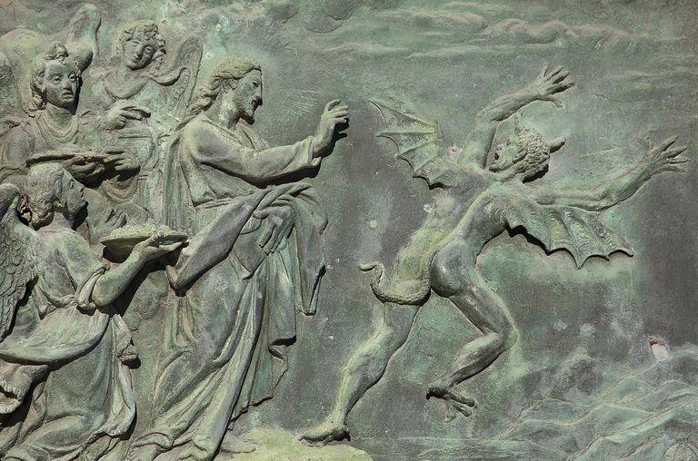 Detail of elaborate bronze door on duomo in Pisa