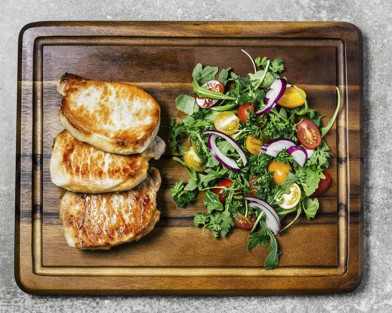 Roasted pork chops with salad