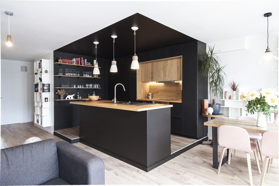 black enclosed kitchen with wood counter