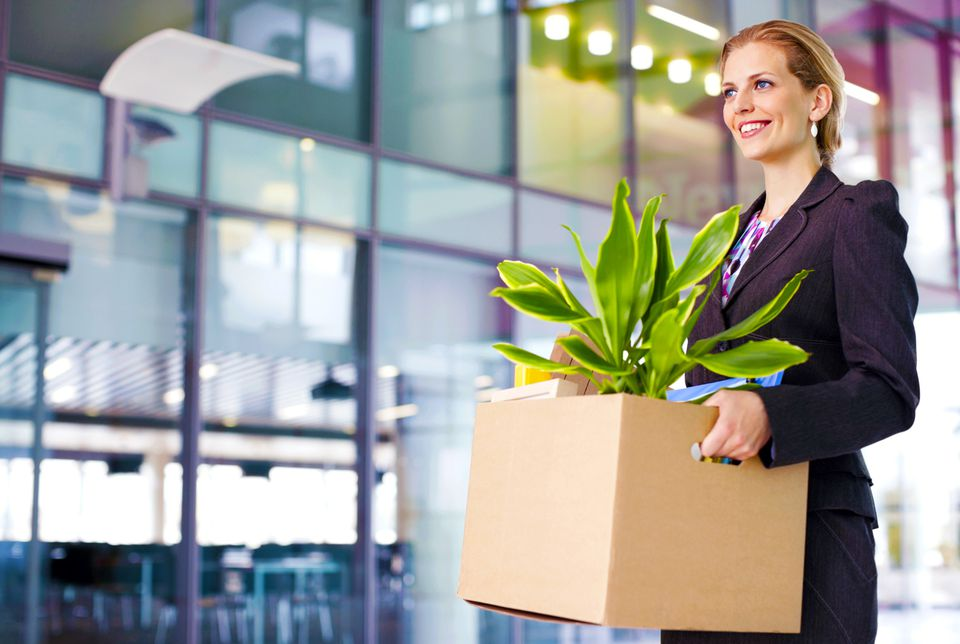 professional woman moving box with a plant