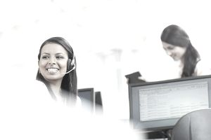 Smiling Computer Support Specialist assisting clients with technology