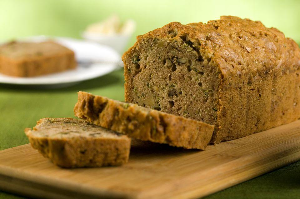 Loaf of zucchini bread on cutting board