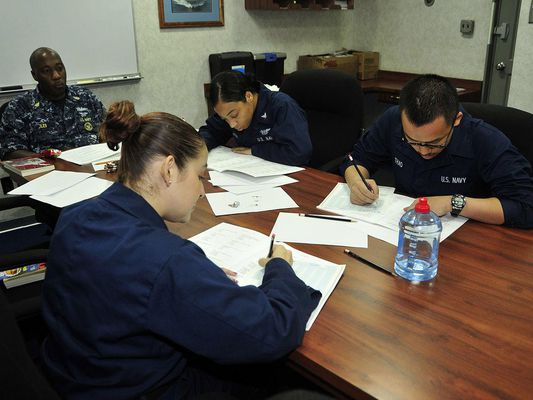 PACIFIC OCEAN (June 27, 2011) Sailors aboard the aircraft carrier USS George Washington (CVN 73) take the Armed Service Vocational Aptitude Battery (ASVAB) test.