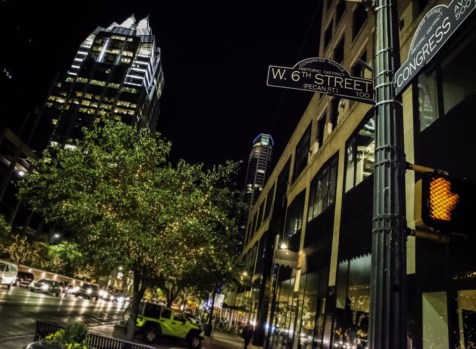 Austin TX downtown night life, 6th congress street sign intersection