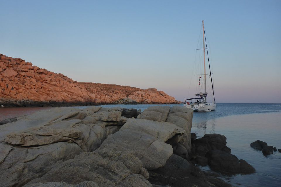 Early evening on the sailboat Baltra at anchor off Greek island of Rinia
