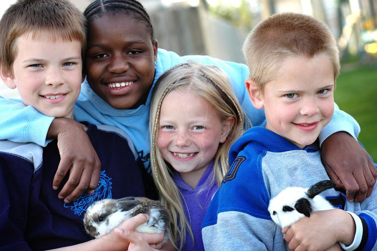Four Happy Children and Two Bunnies