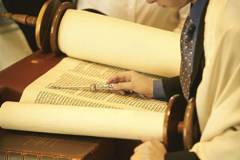 Man reading Torah scrolls
