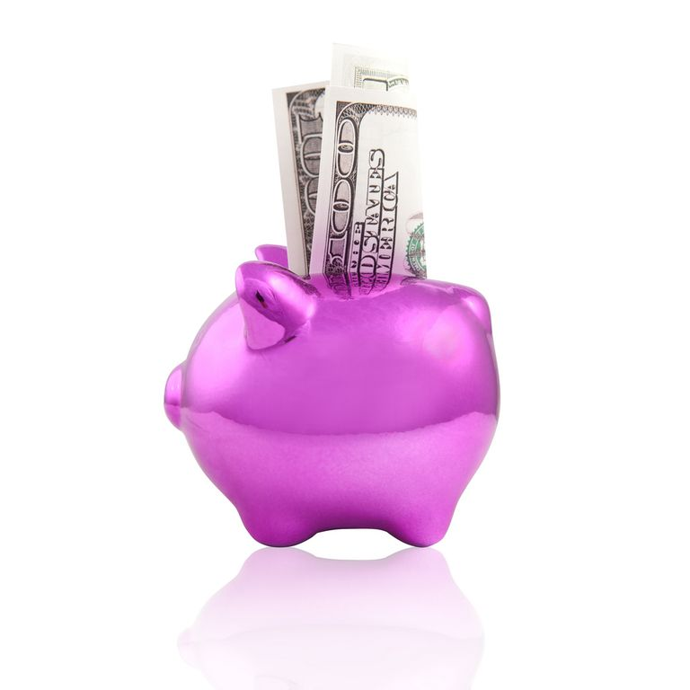 Collecting cash in a piggy bank,