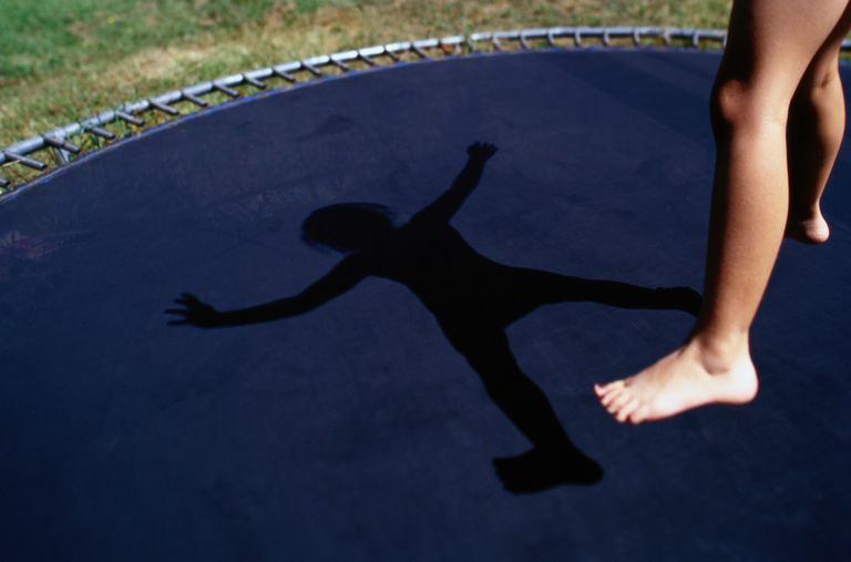 Are trampolines safe - child jumping on backyard trampoline