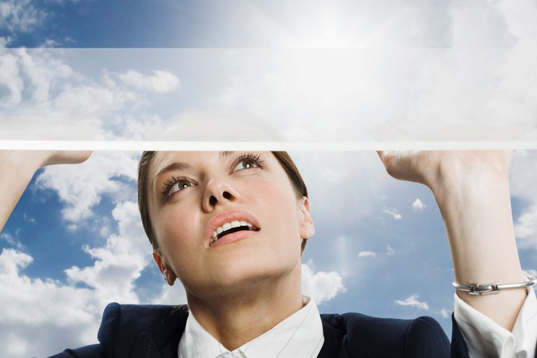 Woman Pushing at Glass Ceiling