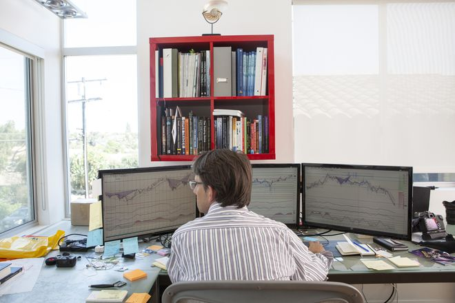 Day trader working in office