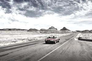 Jaguar XKE driving through the Petrified forest National Park, Arizona