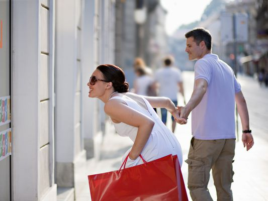 Young Couple Enthusiastically Window Shopping