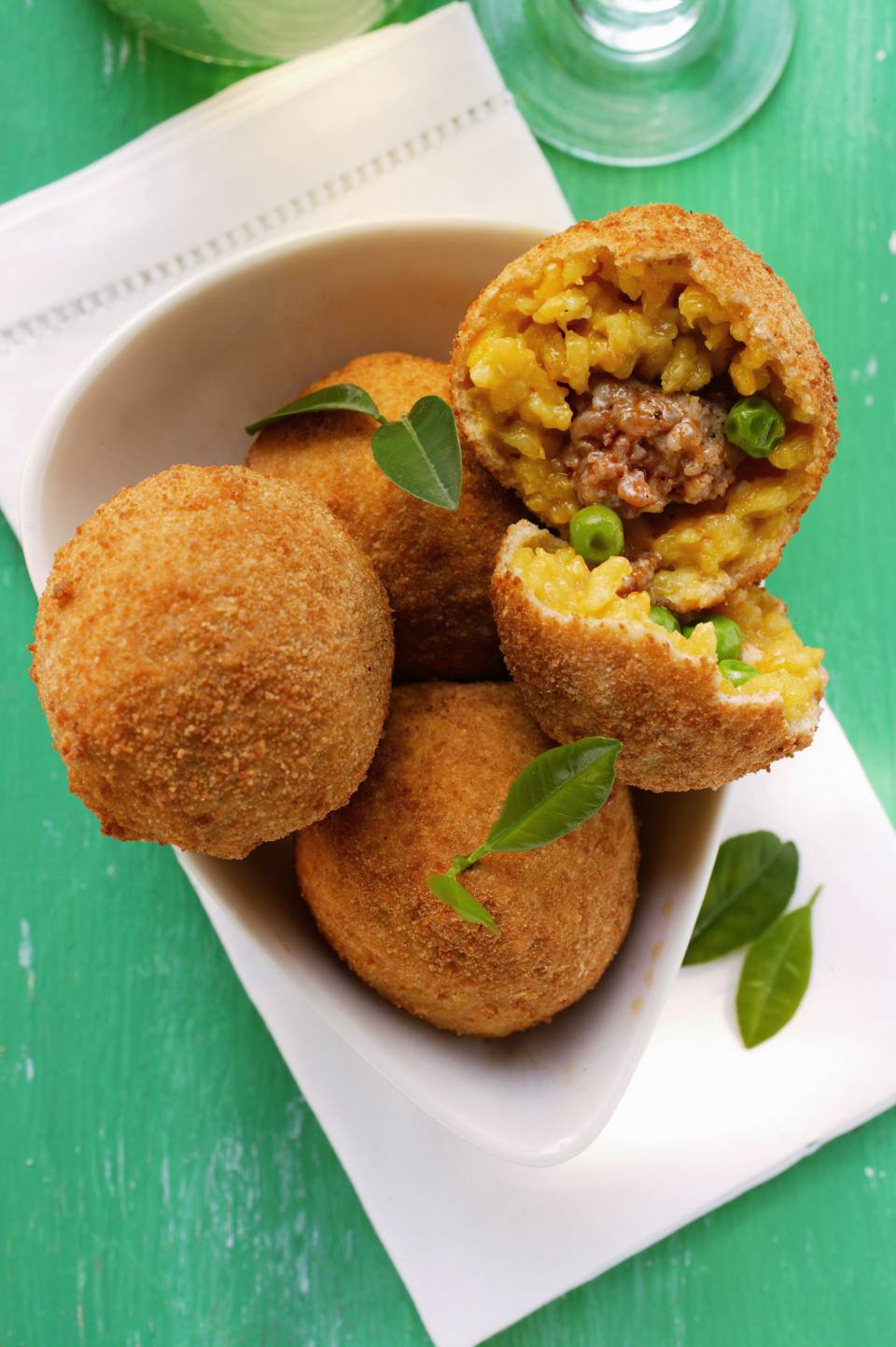 Arancini, Sicilian Rice Balls Stuffed with Meat Sauce and Peas