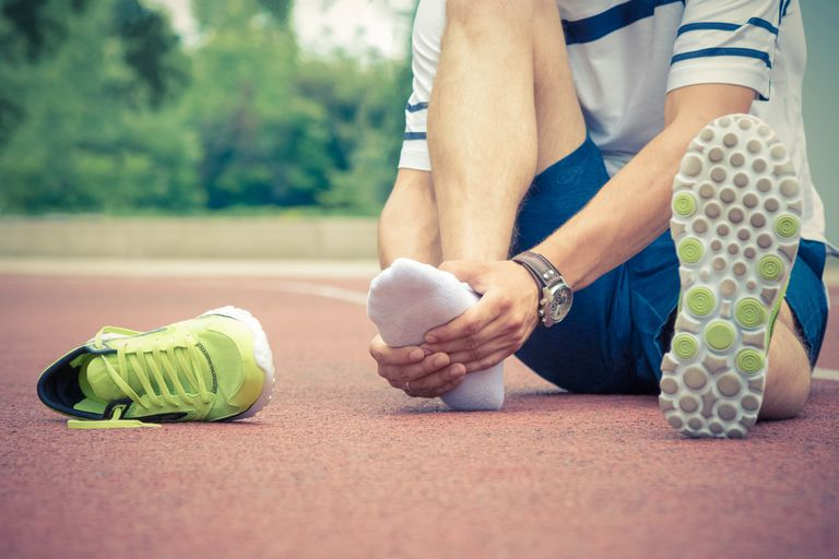Man with foot pain after running