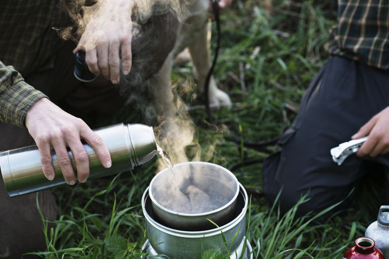 Man pouring hot water out of Thermos