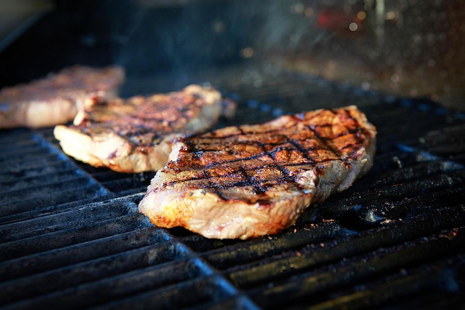 Rib-eye steaks on a gas grill.