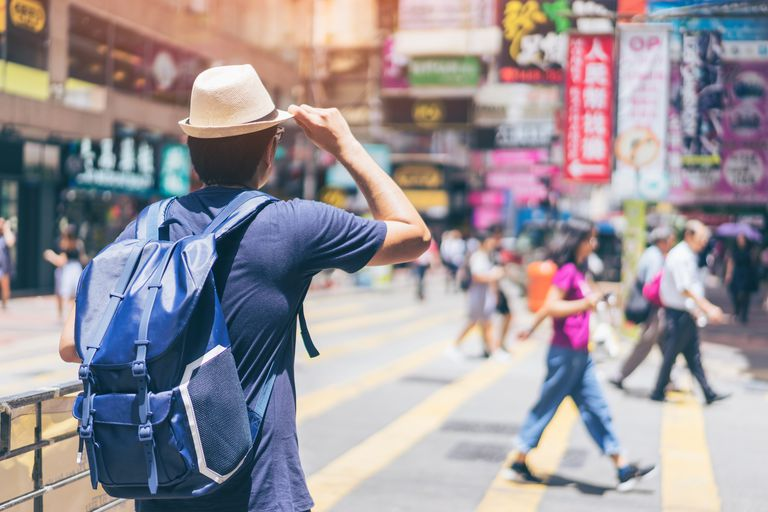 Young man traveler is visiting at Mongkok in Hong Kong