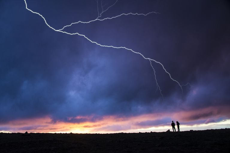 hikers standing in thunderstorm