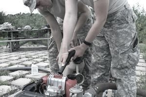 Wisconsin National Guard Soldiers from the 257 Brigade Support Battalion performed their 2-week annual training at Camp Ripley, Minn. this month. Water Treatment Specialists of Alpha Company spent a few days at Lake Ferrell testing the water, their skills and their equipment. Spc. Daniel Clark and Spc. Adeline Barnes fuel the water pump.