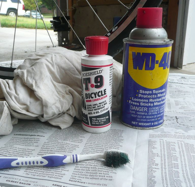 supplies needed for bike chain cleaning: wd-40, brush, rags, solvent