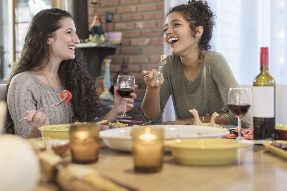 Friends drinking wine over dinner