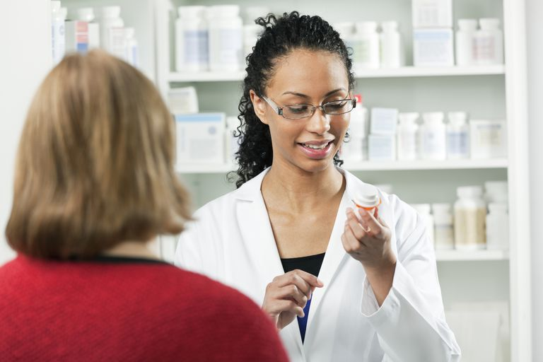 Young Black Woman Pharmacist Helping Customer in Pharmacy Drug Store