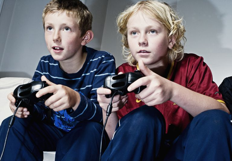 two boys play video game