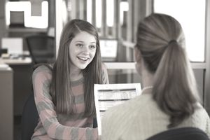 Student talking to guidance counselor