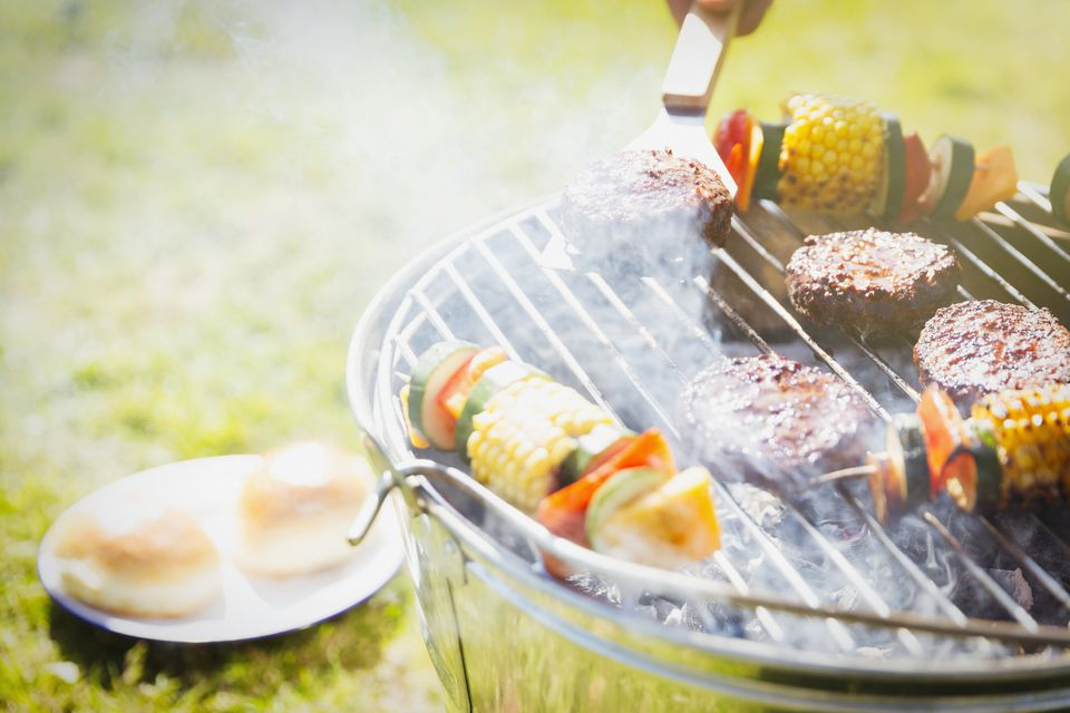 burgers and vegetables on outdoor grill