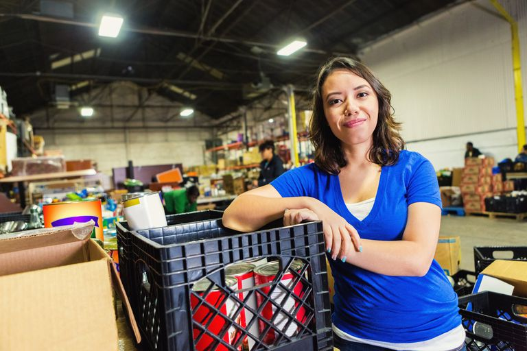 Young woman volunteering at a food bank.