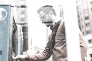 USA, New York City, Businessman using ATM