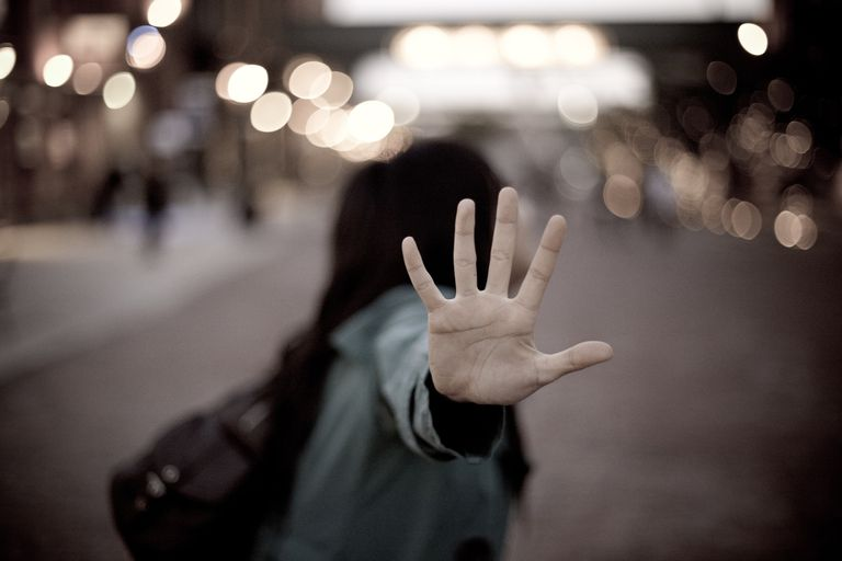 Woman gestures to stop