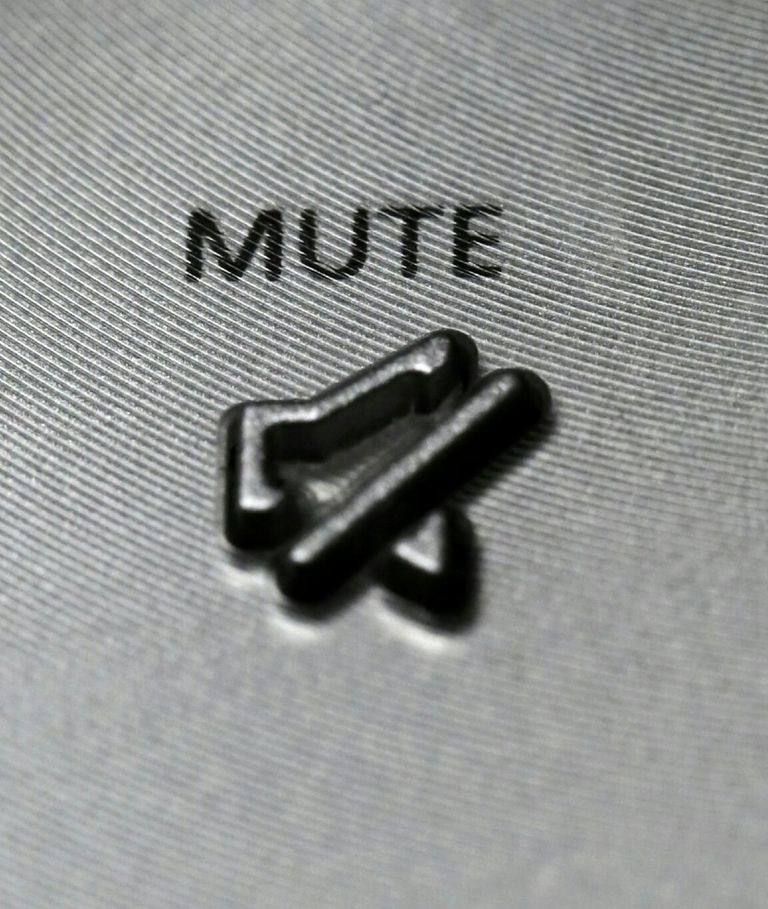 Close-Up Of Mute Sign