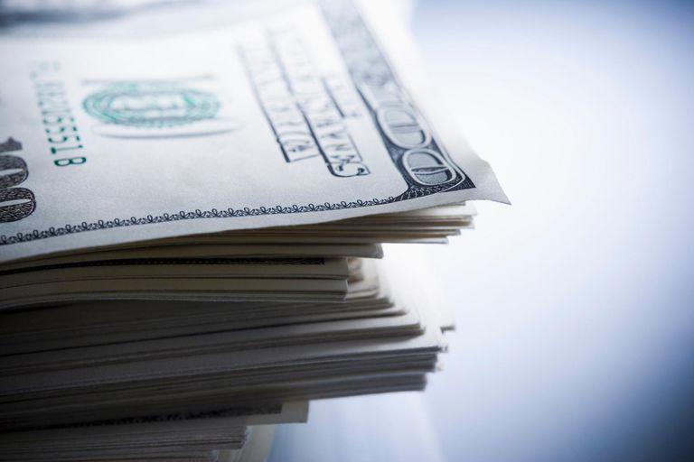 Stack of one hundred dollar bills