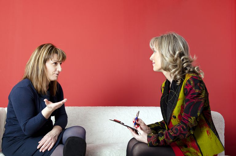 Woman consulting with a female professional