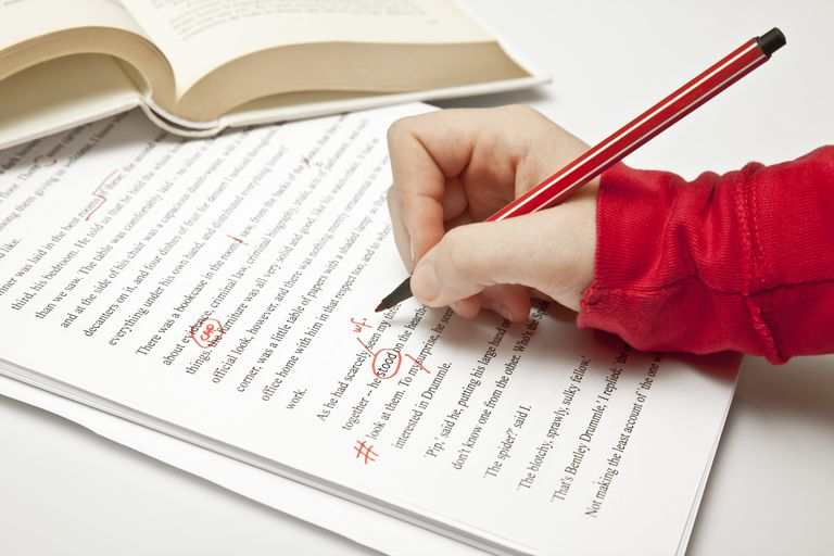 Hand shown proofreading a text