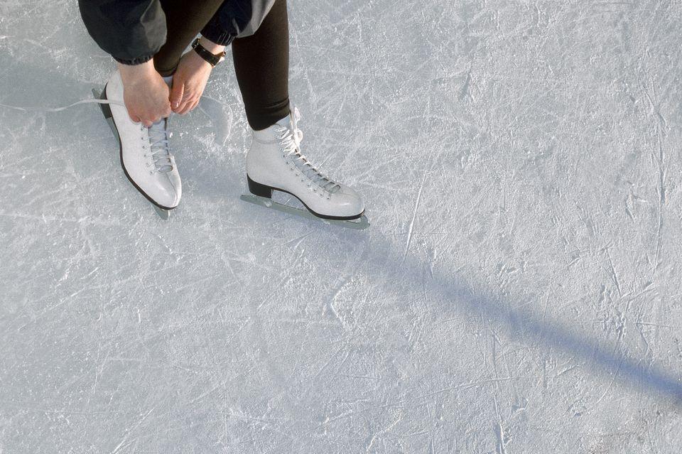 Woman Lacing Ice Skates
