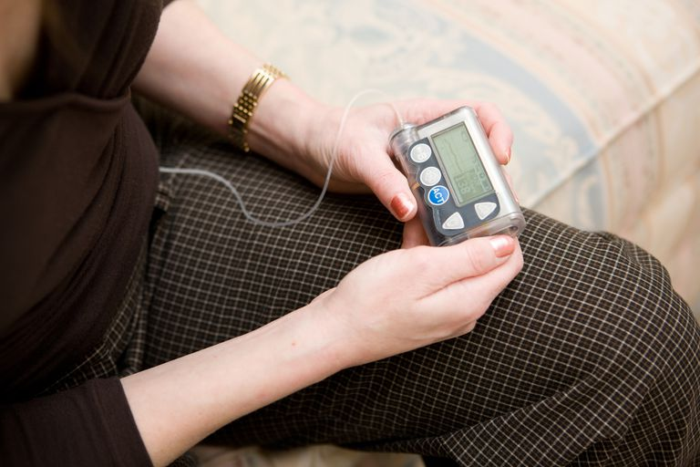 woman checking insulin pump