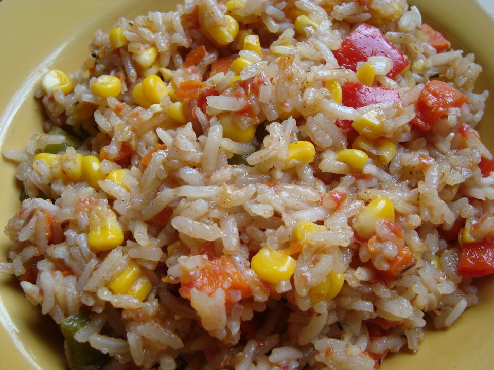 Vegetarian Spanish rice with tomatoes, bell pepper and corn
