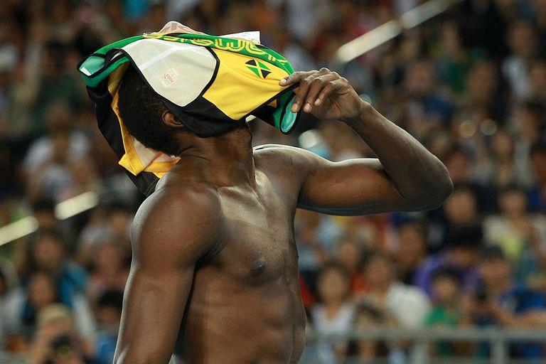 Usain Bolt reacts to False Start